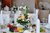 Bridal wedding bouquet on the table — Stock Photo