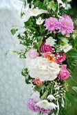 Beautiful wedding setup with flowers on white background — Stock Photo