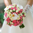 Stock Photo: Wedding bouquet of flowers held by bride