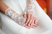 Wedding gloves on the hands of the bride — Stock Photo