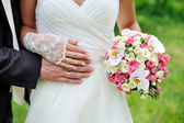 Wedding bouquet of flowers held by a bride — Stock Photo