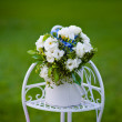 Bouquet of roses hydrangea on decorative metal stand — Stock Photo