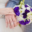 Stock Photo: Bride holding wedding bouquet