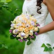 Bride holding wedding bouquet — Stock Photo #28780729
