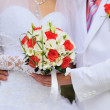 Wedding bouquet in brides hands — Stock Photo #29062069