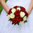 Wedding bouquet in brides hands — Stock Photo