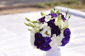 Bouquet of white and violet flowers on a white background — Stock Photo