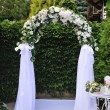 Wedding arch with white flowers — Stock Photo