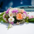 Wedding bouquet of bride lying on table — Stock Photo
