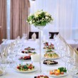 Wedding table at a wedding feast decorated with bridal bouquet — Stock Photo