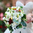Stock Photo: Beautiful wedding bouquet at bride's hands