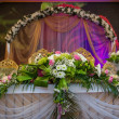Stock Photo: Wedding table decoration with flowers