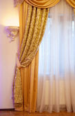 Beautiful gold curtain — Stock Photo