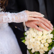 Hands and rings and wedding bouquet — Stock Photo #32536779