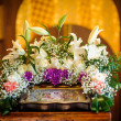 Wedding accessories and interior in Saint Trinity Orthodox Convent including two candlesticks with many candles, flowers, icons and Holy Bible. Wonderful church in Riga, Latvia — Foto Stock