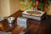 Cross and bible on the wooden table — Stock Photo