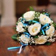 Wedding bouquet on the wooden table — Stock Photo #33199415