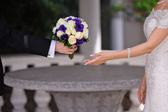 Groom gives the bride a bouquet of roses — Stock Photo