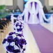 Wedding arch and flowers in church — Stock Photo