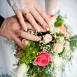 Hands of the bride and groom together — Stock Photo