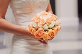 Bride holding a wedding bouquet with white and pink roses — Stock Photo