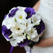 Stock Photo: Wedding bouquet of purple and white flowers