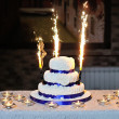 Beautiful wedding cake on a table with candles — ストック写真
