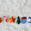 Christmas toys on white snow background — Stock Photo