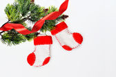 Santa's boots on christmas tree and red ribbon — Foto de Stock
