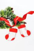 Two Santa's boots on christmas tree and ribbon — Stock Photo