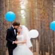 Stock Photo: Bride and groom in forest decorated