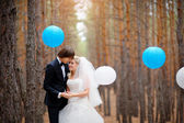 Bride and groom in forest decorated — Stock Photo
