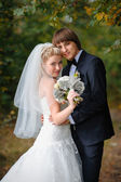 Happy bride and groom at a wedding in the park — Стоковое фото