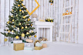 Christmas interior in white and gold color with Christmas tree a — Stock Photo