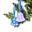 Christmas background, Christmas tree branch with bells toys hand — Stock Photo #37801177
