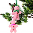 Christmas background with fir-tree branch and pink toys — Stock Photo