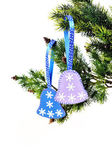 Christmas background, Christmas tree branch with bells toys hand — Stock Photo