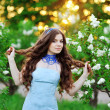 Stock Photo: Beautiful womwith flowers of lilac