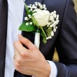 White rose boutonniere on suit of the groom — Stock Photo