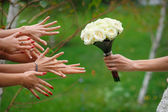 Bride stretches a beautiful wedding bouquet — Stock Photo