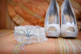 Wedding accessories and bridal shoes on the table — Stock Photo