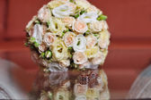 Wedding bouquet of pink and white roses — Stock Photo