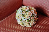 Wedding bouquet on sofa — Stock Photo