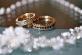 Gold wedding rings laying on the table — Stock Photo