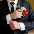 Wedding details, cufflinks, elegant male suit and hands — Stock Photo