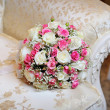 Stock Photo: Bridal bouquet lying on sofa