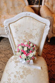 Bridal bouquet lying on the chair — Stock Photo