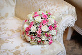 Bridal bouquet lying on the sofa — Stock Photo