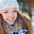 Portrait of beautiful girl on street in winter — Stock Photo #40976965