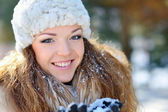 Portrait of a beautiful girl on the street in winter — Stock Photo